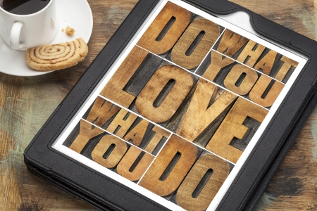 do what you love, love what you do - motivational word abstract in vintage letterpress wood type on a digital tablet Stok Fotoğraf
