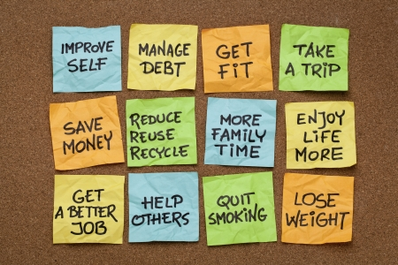 popular new year resolutions - colorful sticky notes on a cork board Stock Photo