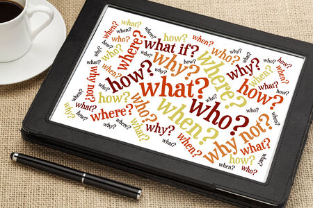 what if: who, what, when, where, why, how questions - brainstorming concept  - word cloud on a digital tablet with a cup of coffee