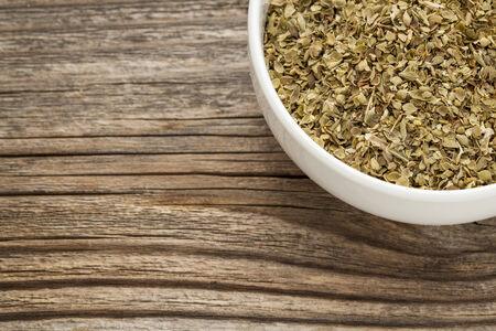dry oregano herb - a ceramic bowl