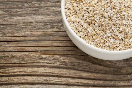 oat bran - a ceramic bowl Stok Fotoğraf