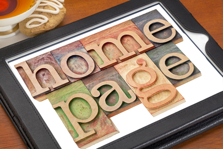home page - text in letterpress wood type on a digital tablet with cup of tea Stock Photo - 24634822