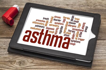 asthma word cloud on a digital tablet screen with an inhaler Stock Photo - 24634828