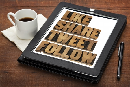 tweet: like, share, tweet, follow words - social media concept - isolated text in vintage letterpress wood type on a digital tablet with cup of coffee Stock Photo