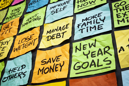 fitness goal: new year goals or resolutions - colorful sticky notes on a blackboard