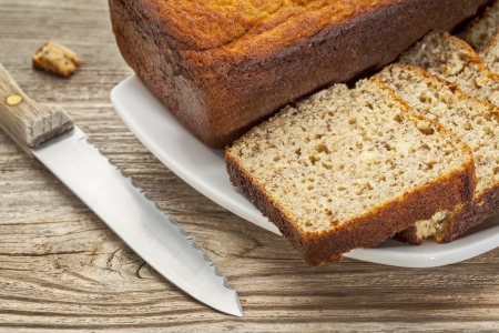 baked bread: slices of freshly baked, gluten free bread made with almond and coconut flour and flaxseed meal Stock Photo