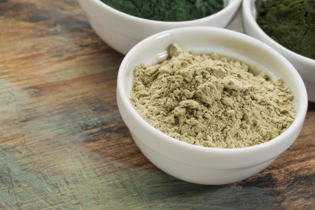 a bowl of kelp seaweed powder with spirulina and chlorella in background Stock Photo - 24733506