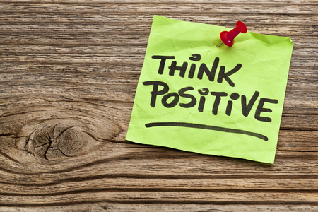 think positive reminder note against grained weathered wood Stock Photo - 24733507