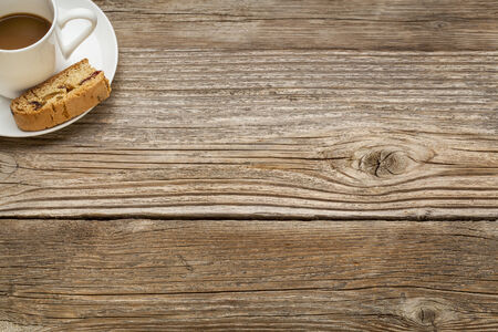 espresso coffee cup with a cookie on a rustic wooden table - copy space Stock Photo - 24732444