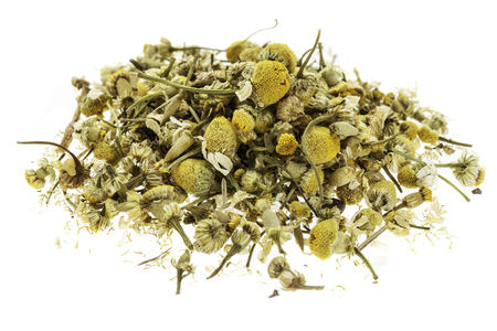 chamomile tea: isolated heap of dry chamomile herb with flowers Stock Photo