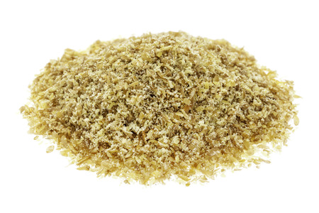 isolated small heap of golden flax seed meal Stock Photo - 24876211