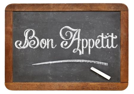 Bon Appetit - white chalk text on a vintage slate blackboard Stock Photo - 24876214