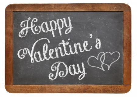 Happy Valentine's Day - whtie chalk text on a vintage slate blackboard Stock Photo - 24876215