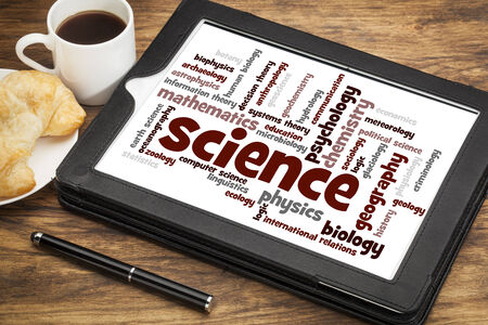science branches word cloud on a digital tablet with a cup od coffee photo