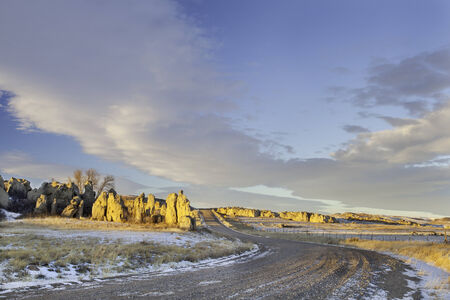 back country road over prairie in northern Colorado with Natural Fort geological landmark Stock Photo - 24959907