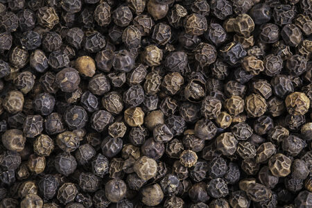 dry black peppercorns background and texture
