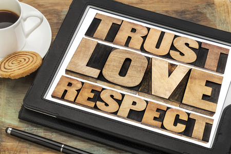 trust, love and respect word abstract in vintage letterpress wood type on a digital tablet Stok Fotoğraf