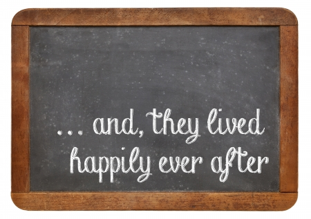 and, they lived happily ever after -  stock phrase for ending oral narratives or fairytale on a vintage blackboard Imagens