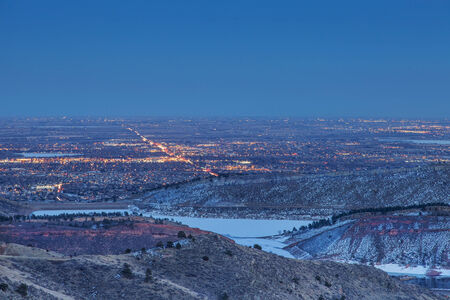 horsetooth reservoir: night view of Fort Collins in Colorado with foothills and Horsetooth Reservoir, winter scenery