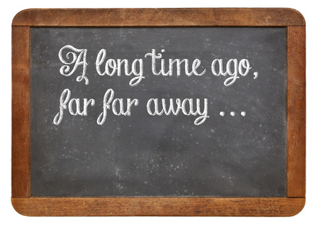 narratives: A long time ago, far, far away - a phrase for opening oral narratives, story or fairytale on a vintage blackboard, copy space below