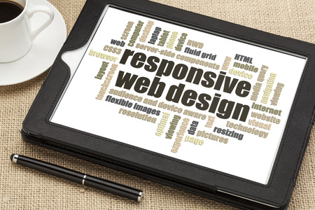 design web: responsive web design word cloud  on a digital tablet with a cup of coffee