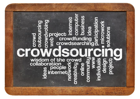 crowdsourcing: crowdsourcing word cloud on a  vintage slate blackboard isolated on white