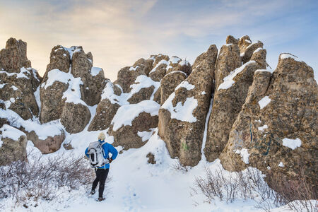 geologic: a hiker in Natural Fort sculpted from sandstone (Oligocenne White River Formation) by erosion - geologic and historic landmark on prairie in northern Colorado Stock Photo