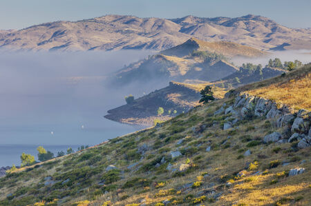 foothills: fog over Horsetooth Reservoir in Rocky Mountain foothills near Fort Collins, Colorado, late summer morning