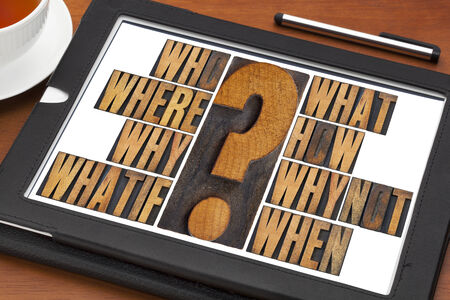 brainstorming or decision making concept - who, what, where, when, why, how, whatif and why not questions - a collage of words in vintage letterpress wood type on a digital tablet photo