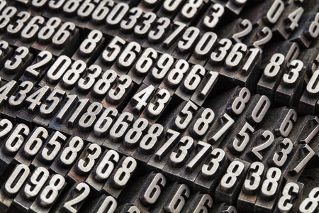 numbers abstract: random numbers in vintage, grunge, dusty metal letterpress printing blocks Stock Photo