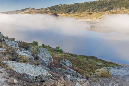 horsetooth reservoir: fog over Horsetooth Reservoir in Rocky Mountain foothills near Fort Collins, Colorado, late summer morning
