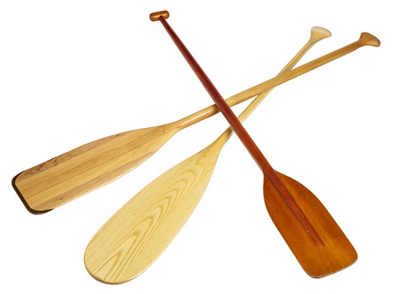 canoe paddle: three wooden canoe paddles isolated on white with clipping paths Stock Photo