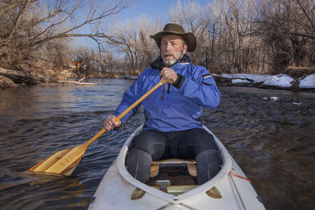 paddler: senior canoe paddler in a decked expedition canoe Stock Photo