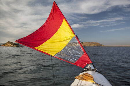 horsetooth reservoir: canoe bow with a downwind sail  on Horsetooth Reservoir in Colorado near Fort Collins