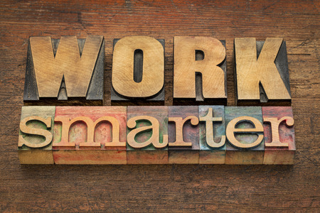 smarter: work smarter advice in vintage letterpress wood type - efficiency concept Stock Photo