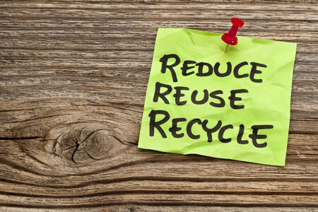 reduce, reuse and recycle reminder note against grained wood - resource conservation concept Stok Fotoğraf