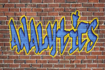 analytics word -  graffiti style text on a old grunge brick wall photo