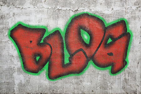 blog word -  graffiti style text on an old grunge plaster wall photo