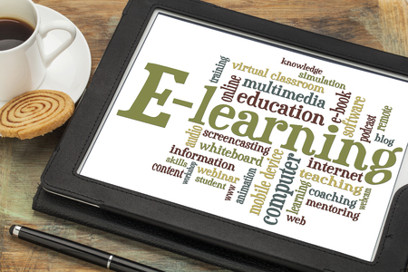 online education: online education concept - e-learning word cloud on a digital tablet with a cup of coffee