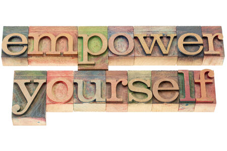 yourself: empower yourself  - isolated text in letterpress wood type Stock Photo