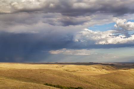 soapstone: heavy storm clouds over a rolling prairie at foothills of Rocky Mountains in Colorado - Soapstone Prairie Natural Area near Fort Collins