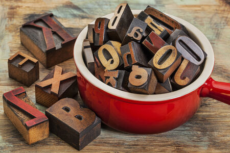 typography concept - a pot of letterpress wood type printing blocks