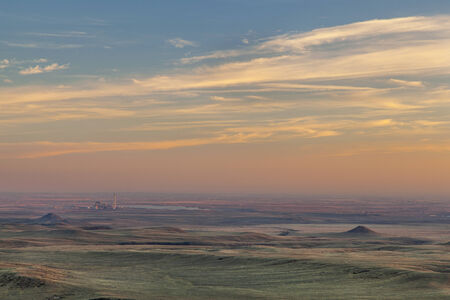 collins: sunset over prairie in northern Colorado near Fort Collins with a distant power plant Stock Photo
