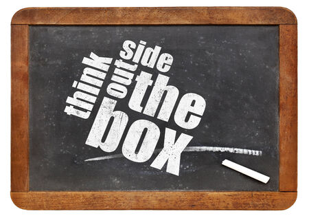 think outside the box concept on a vintage slate blackboard photo