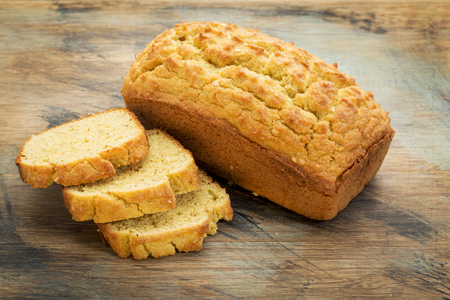 baking bread: slices and loaf of freshly baked, gluten free bread made with almond and coconut flour and flaxseed meal Stock Photo
