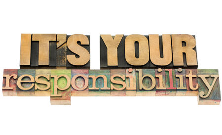 it is your responsibility - isolated text in vintage letterpress wood type blocks 版權商用圖片