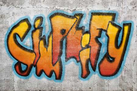 simplify: simplify  word -  graffiti style text on an old grunge plaster wall Editorial