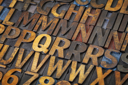 letterpress: alphabet abstract - vintage letterpress wood type printing blocks stained by black, blue and red ink