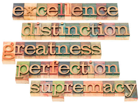 supremacy: excellence, distinction, greatness, perfection and supremacy - a collage of isolated words in letterpress wood type blocks stained by color inks