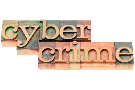 cybercrime: cybercrime word - isolated text in  letterpress wood type blocks stained by color inks